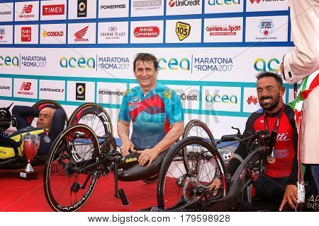 Rome Italy - April 2 2017: Alex Zanardi is the winner of the hand bike race of 23 ^ Rome Marathon. On stage together for the second place Cratassa Mauro (left) and third prize Giagnoni Christian.