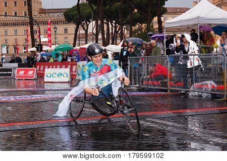 Rome Italy - April 2 2017: Alex Zanardi is the winner of the hand bike race of 23 ^ Rome Marathon. Zanardi arrival at the finish line in the rain.