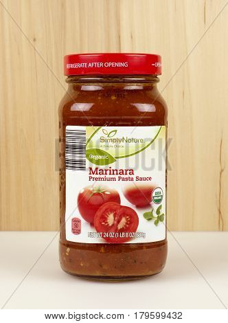 RIVER FALLS,WISCONSIN-MARCH 08,2017: A jar of Simply Nature brand Marinara pasta sauce with a wood background.