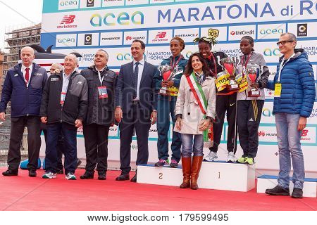 Rome Italy - April 2 2017: The mayor of Rome Virginia Raggi and other authorities on stage with the top three women's race of the 23rd marathon in Rome.