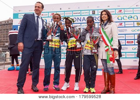 Rome Italy - April 2 2017: The mayor of Rome Virginia Raggi on stage with the top three women's race of the 23rd marathon in Rome. At the center of Chota Rahma Tusa first. To his right Shankutie Mestawot Tadesse second place. To his left Gebremeskel Ababa