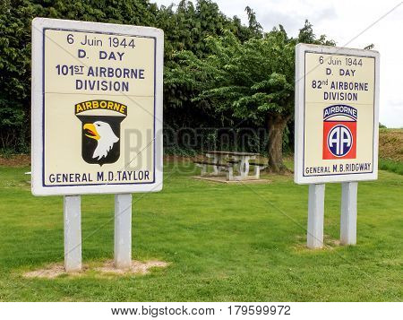 At the entrance of Sainte Mere Eglise town in Normandy two panels honor the memory of American Army airborne divisions that landed during the D-Day.