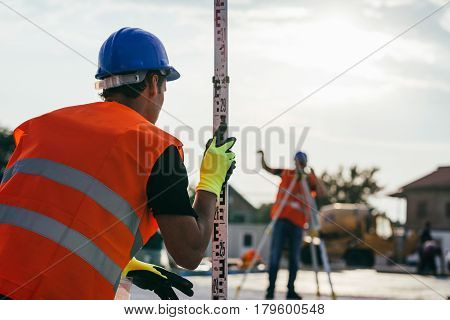 Surveyors on construction site ,  color image, outdoors