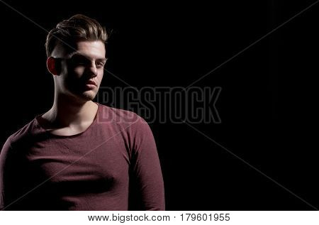 Handsome Man With Stylish Haircut In Dark Red Tshirt