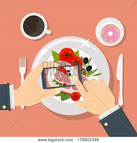 Taking food fotos. Hands holding smartphone and taking fotos of steak.