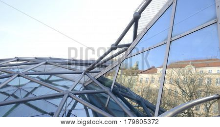 GRAZ, AUSTRIA - MARCH 20, 2017: Reflections of building on the crystal of the Mur Island in Graz the capital of federal state of Styria Austria.