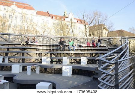 GRAZ, AUSTRIA - MARCH 20, 2017: Outdoor Cafeteria at the platform of the Mur Island in Graz the capital of federal state of Styria Austria.