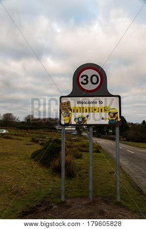 Sign For Village Of Minions, Showing Characters From Movie. Bodmin Moor, Cornwall, United Kingdom.