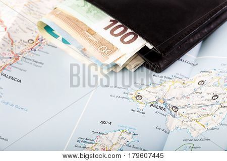 European union currency in a wallet on a map background. Travel concept.