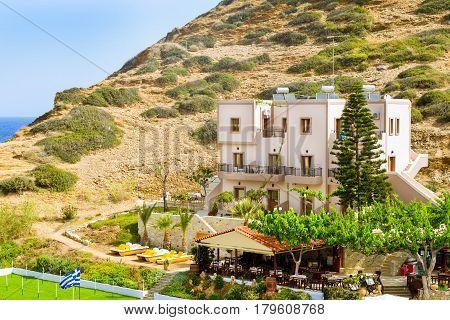 Comfortable hotel and tavern buildings. Resort Greek architecture. Sandy Evita and Karavostasi beach in sea bay of resort village Bali. Rethymno Crete Greece