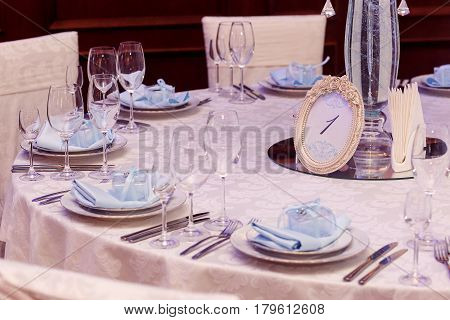 Luxury Wedding Reception. Stylish Numder One Of Tables And Glasses, Plates And Silver Cutlery And Gi