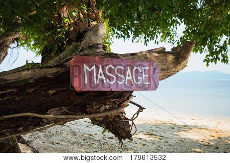 Old Signboard With The Inscription, Massage, On A Tropical Beach