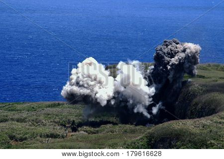 Bomb detonation, Saipan Billows of smoke rose from the Laderan Lagunn Cliff as thousands of pounds of vintage bombs unearthed from all over the island were detonated in Saipan. The detonation is done at least once a year by the U.S. Navy Explosive Ordnanc