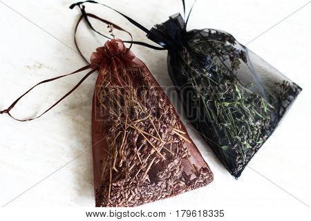 Dried Scented Herbs In Red Decorative Bags: Brown And Black. Fresh Smell Of Meadow In Your House