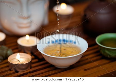 Chinese tea ceremony with candles. Close up photo.