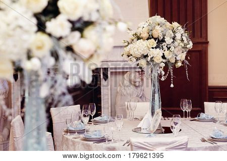 Luxury Decorated Tables At Rich Wedding Reception. Stylish Arrangements Of Flowers And Jewels On Tab