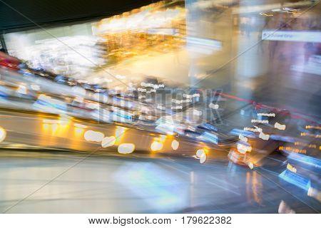 London, UK - November 30, 2016:  Multiple exposure image of underground station entrance with escalators in Canary Wharf.