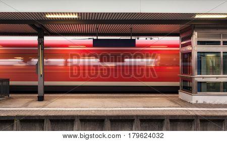 Railway Platform With High Speed Red Passenger Train