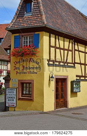Eguisheim France - july 23 2016 : wine grower in the historical village in summer