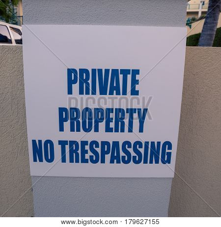 Private property and no trespassing sign on white