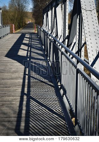background Early evening shadow over the iron bridge