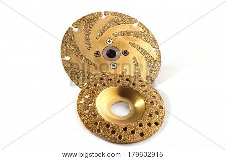 two gold studded diamond blades on white background isolated