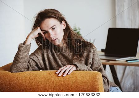 indoor portrait of beautiful feminine thoughtful young women alone in the room.