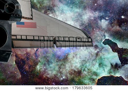 Space Shuttle over galaxy and space nebula. Elements of this image furnished by NASA.