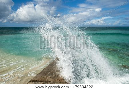 The wave hitting the pier in Cockburn Town on Grand Turk island (Turks & Caicos).