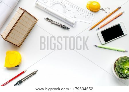 Construction office with architect working tools and phone on white table background top view mockup