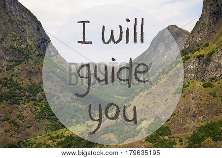 English Text I Will Guide You. Valley With Mountains In Norway. Peaceful Landscape, Scenery With Grass, Trees And Rocks.