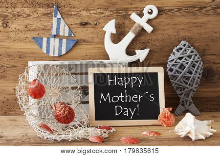 Blackboard With Nautical Summer Decoration And Wooden Background. English Text Happy Mothers Day. Fish, Anchor, Shells And Fishnet For Maritime Contex.