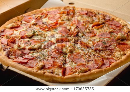 Fresh hot meat pizza in a box, delivery of fast food concept