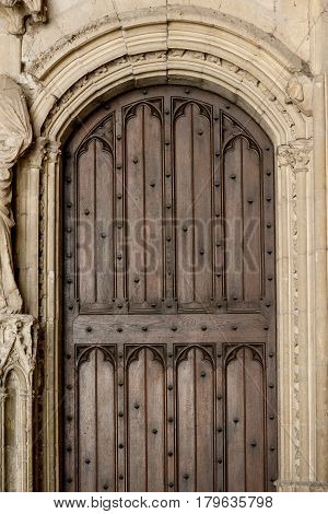 Wooden antique door of historic Papal Palace, Avignon, France