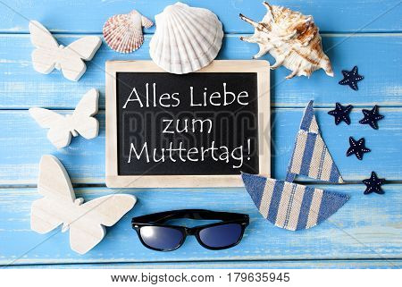 Flat Lay Of Chalkboard On Blue Wooden Background. Nautical Summer Decoration As Holiday Greeting Card. German Text Alles Liebe Zum Muttertag Means Happy Mothers Day