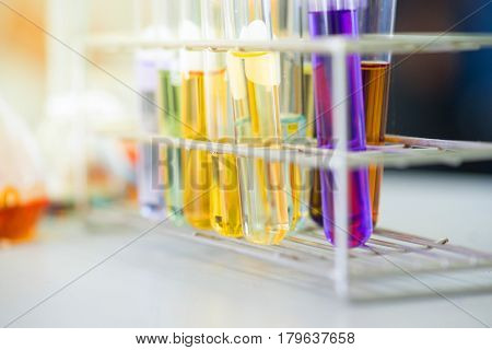 Test tube with colorful liquids in laboratory.