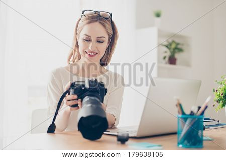 Young Pretty Cute Photographer Checking Photos On A Camera