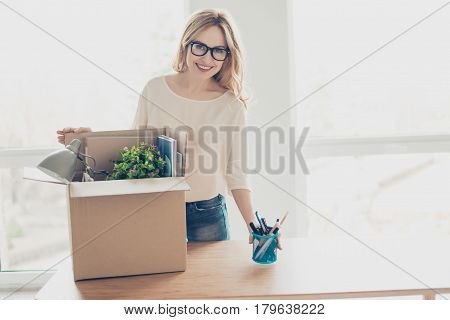 Concept Of Promotion At Work. Portrait Of Attractive Woman In Spectacles Unpacking Her Belongings At