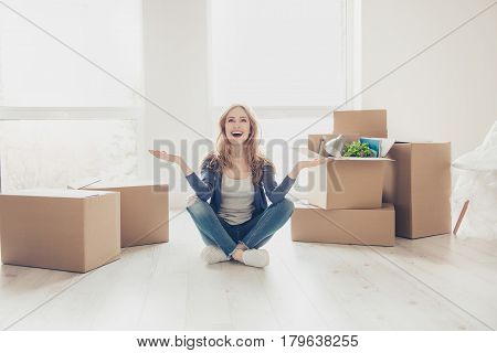 Woman Unlimitedly Happy Because Of Moving New House Of Her Dream, Sitting On The Floor With Lots Of