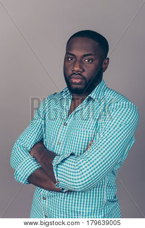 Portrait Of Successful Serious  Handsome Afroamerican Man In Shirt Crossed Hands