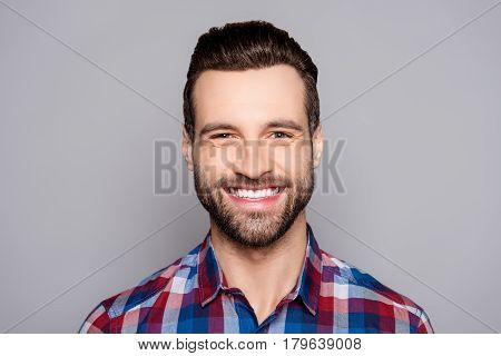 A Close Up Portrait Of Young Happy Cheerful Young Man In Checkered Shirt In Front Of Gray Background
