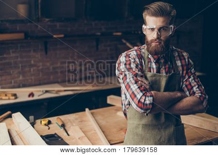 Bearded Handsome Joiner  Think And Look At Camera Near Tabletop With Tools.  Stylish Young Entrepren