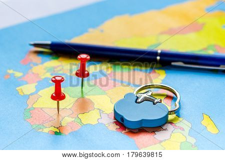 Travel preparation and booking concept with pen on touristic map background