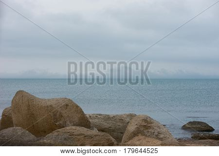 Classic spring picture of caspian sea with montains rocks and Gloomy blue sky Baku Azerbaijan