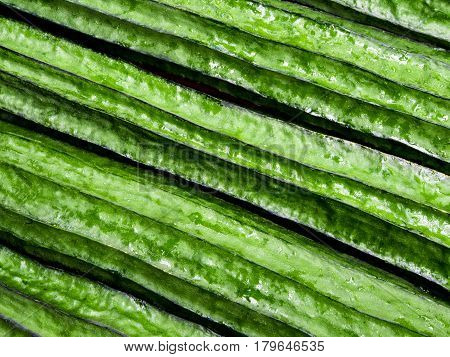 Texture of fresh angled loofah green vegetable