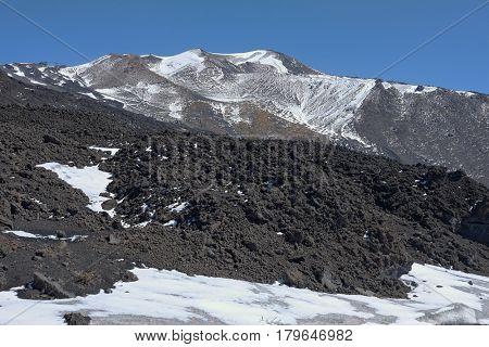 volcanic rock in winter Etna Park, Sicily