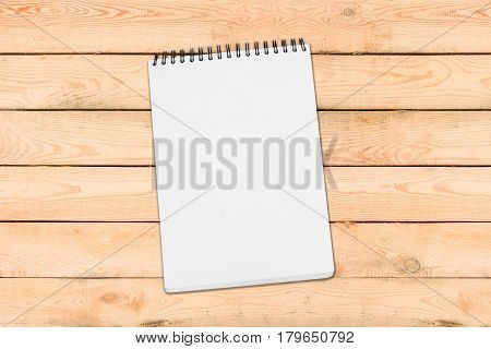 Blank White Spiral Bound Paper Drawing Pad With Shadow Isolated On Wooden Background