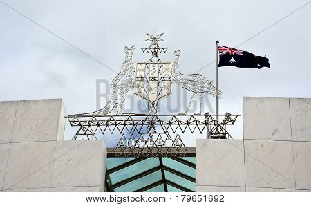 Canberra Australia - March 18 2017. Australian Emu and Kangaroo emblem on the Parliament House. The Australian Coat of Arms on top Parliament House Canberra Australia.