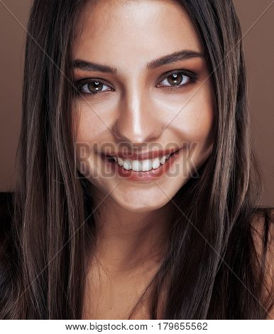 cute happy young indian real woman in studio close up happy smiling, fashion mulatto