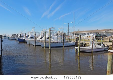 NAGS HEAD NORTH CAROLINA - FEBRUARY 20 2017: Charter fishing boats and store for excursions into the waters of Pamlico Sound and the Atlantic Ocean at the Oregon Inlet Fishing Center.